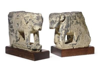 A pair of gray schist figures