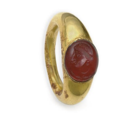 A gold ring with carnelian rin