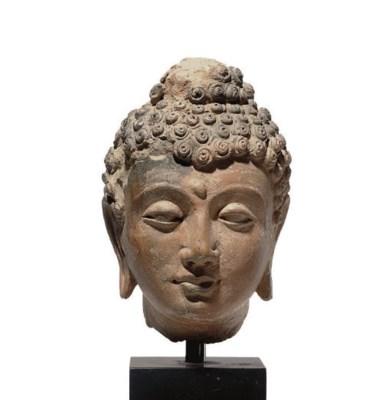 A rare terracotta head of Budd