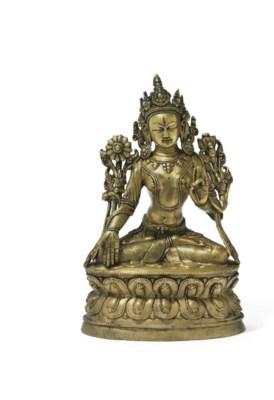 A rare bronze figure of Tara