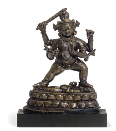 A bronze figure of Virupa