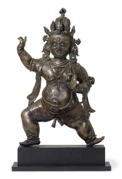 A bronze figure of a protector
