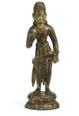 A rare Gilt copper figure of P