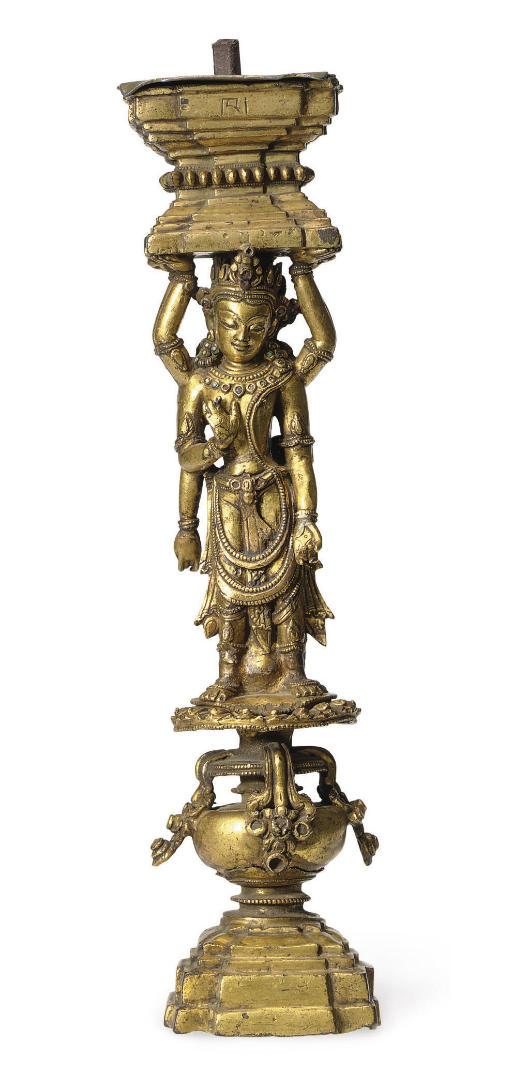 A gilt bronze support