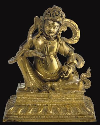 A gilt bronze figure of Kubera