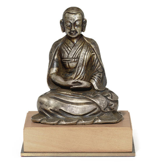 A rare silver figure of a Lama