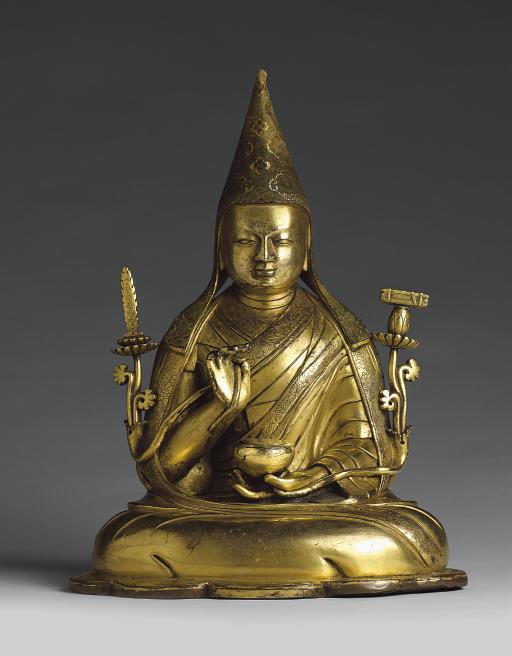 A large gilt bronze figure of Tsong Khapa