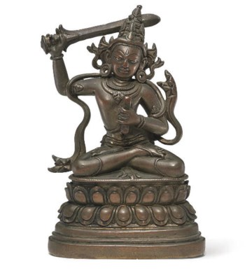 A small bronze figure of Manju