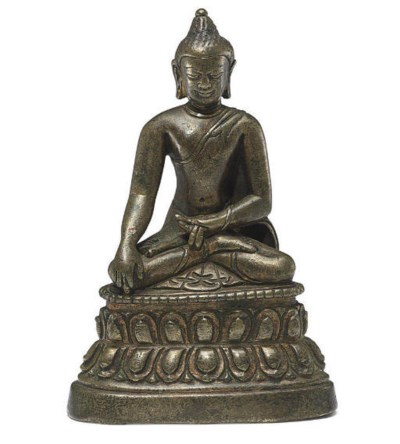 A small bronze figure of Buddh