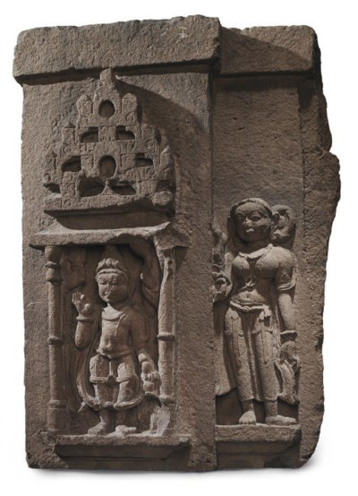 A large red sandstone relief