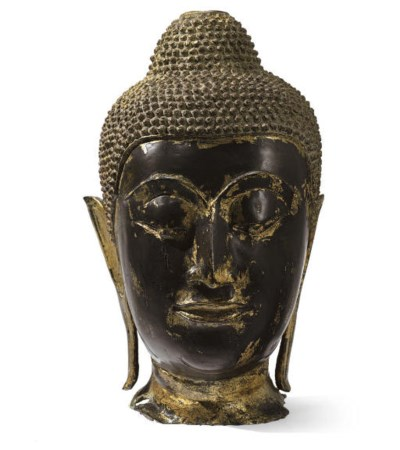 A gold lacquered bronze head o