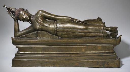 A large bronze figure of a reclining Buddha