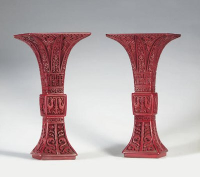 A PAIR OF CARVED RED LACQUER A