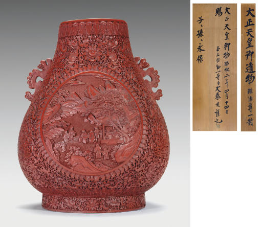 A RARE LARGE CARVED RED LACQUE