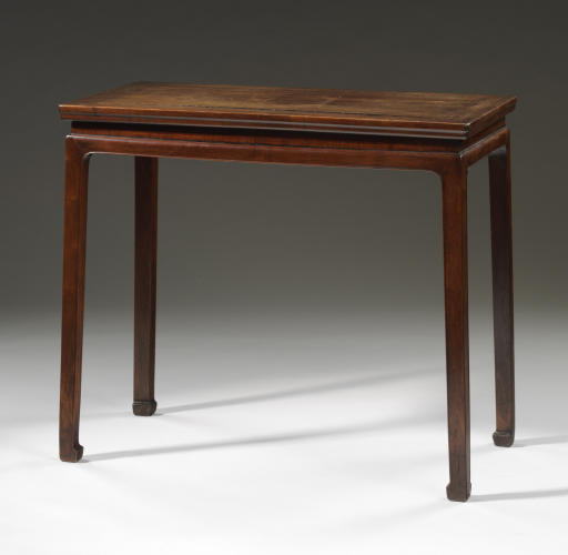 A SMALL HUANGHUALI WAISTED CORNER-LEG SIDE TABLE, BANZHUO