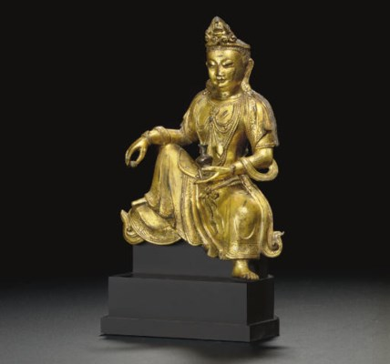 A SMALL GILT-BRONZE FIGURE OF