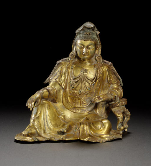 AN UNUSUAL GILT-BRONZE FIGURE