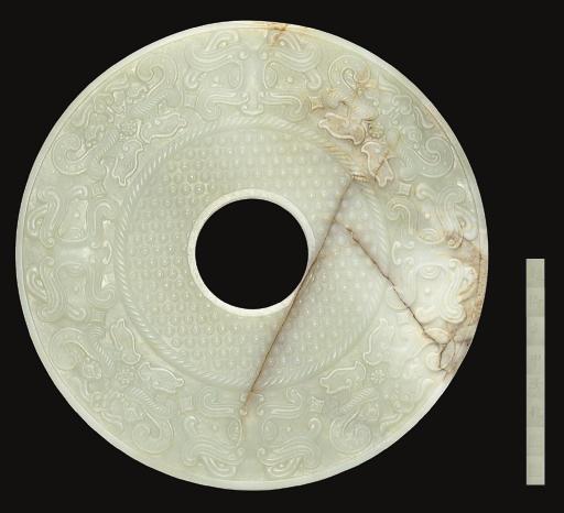 A RARE INSCRIBED LARGE WHITE JADE ARCHAISTIC BI