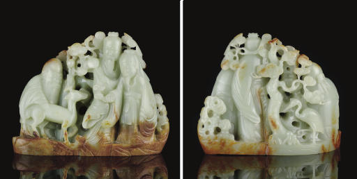 A GREYISH-WHITE AND RUSSET JADE GROUP OF THE STAR GODS
