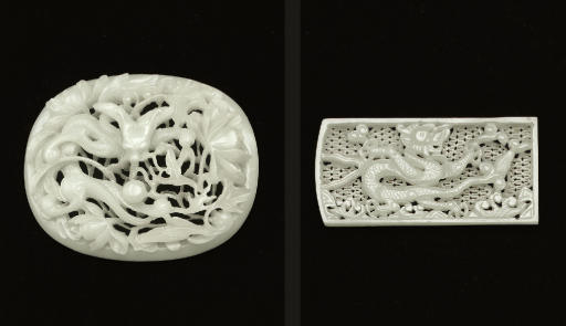 TWO WELL-CARVED WHITE JADE PIE