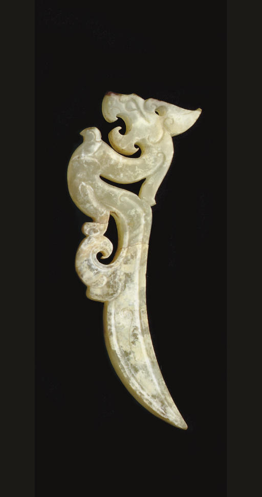 A FINELY CARVED GREENISH-WHITE
