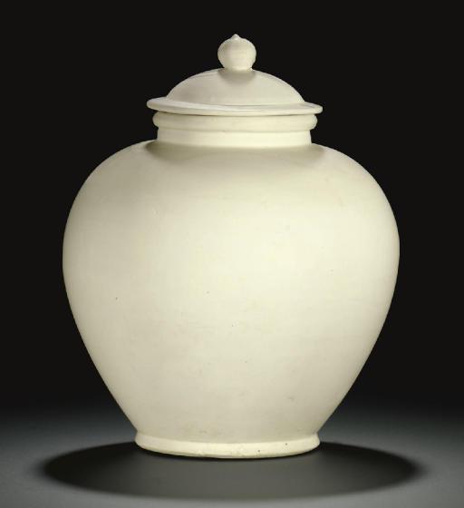A GLAZED WHITE WARE BALUSTER J
