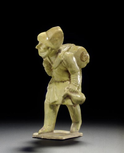 A STRAW-GLAZED POTTERY FIGURE