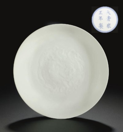 A RARE WHITE-GLAZED RELIEF-DEC