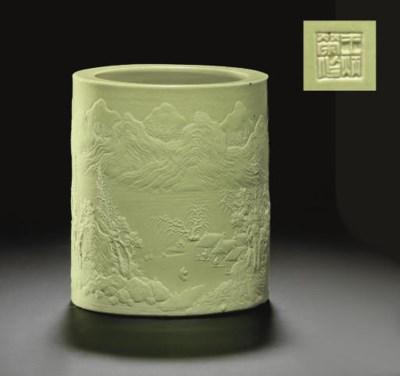 A PALE LIME-GREEN-GLAZED CARVE