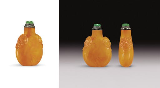 **A CARVED AMBER SNUFF BOTTLE