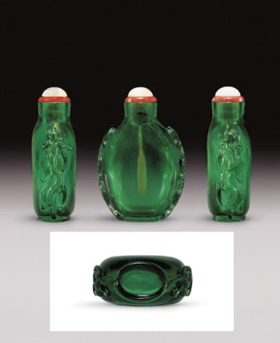 **A CARVED EMERALD-GREEN GLASS