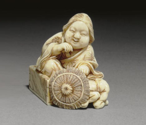 An Ivory Netsuke and Two Wood