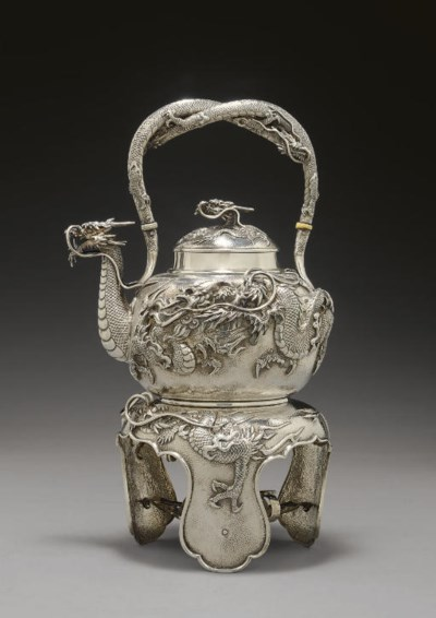 A Silver Tea Kettle and Stand