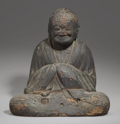 A Seated Wood Figure of Sogyo