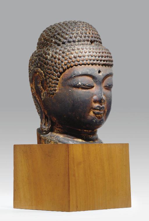 A Wood Head of the Buddha