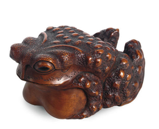 A JAPANESE WOOD MODEL OF A TOAD,