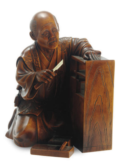 A JAPANESE WOOD CARVING OF A C
