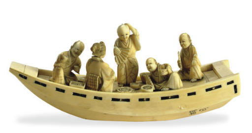 A JAPANESE IVORY MODEL OF FIGU