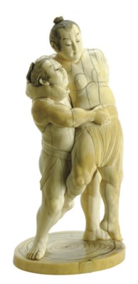A JAPANESE IVORY CARVING OF TW