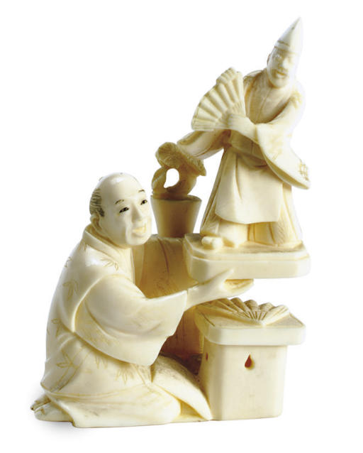 A JAPANESE IVORY NETSUKE OF A