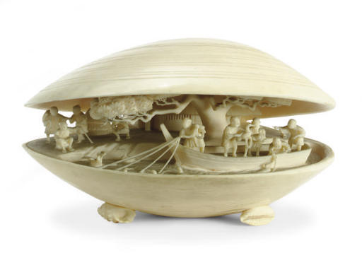 A JAPANESE IVORY CARVED CLAM S