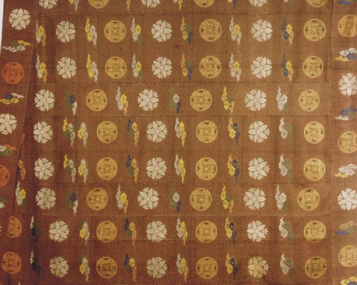 A JAPANESE SILK BROCADE DARK P