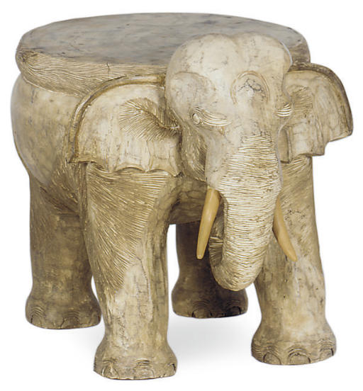 A CARVED GREY-PAINTED ELEPHANT
