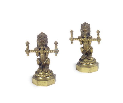 A PAIR OF POLISHED BRASS LION