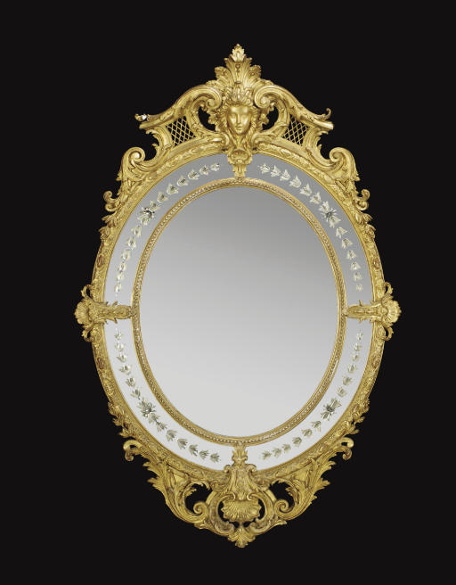 A GILTWOOD OVER-MANTEL MIRROR