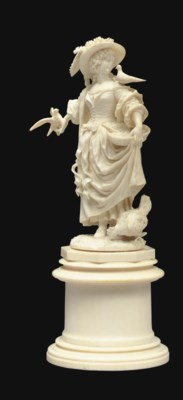 A FRENCH IVORY FIGURE OF A LAD