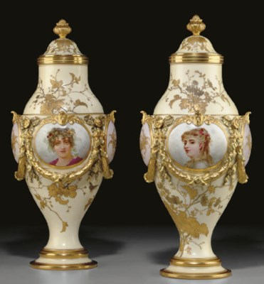 A PAIR OF CONTINENTAL IVORY-GR