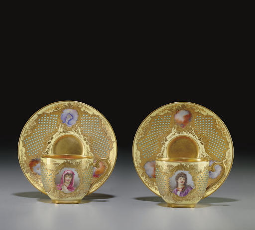 A PAIR OF COALPORT 'JEWELED' YELLOW-GROUND PORTRAIT CUPS AND SAUCERS