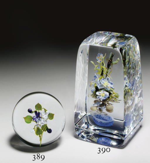 A PAUL STANKARD BOTANICAL BOUQUET, INSECT AND 'EARTH SPIRIT' UPRIGHT WEIGHT