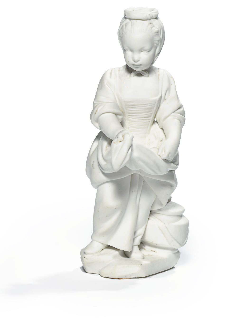 A SEVRES BISCUIT FIGURE OF AN